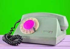 Retro telefon na żółtym pastelowym tle Obrazy Royalty Free