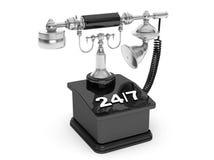 Retro- Telefon Weinlese-Telefon mit 24/7 Zeichen Lizenzfreie Stockfotos