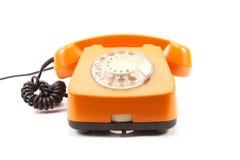 Retro telefono arancione immagine stock