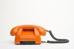 Retro telefono arancione Immagine Stock Libera da Diritti