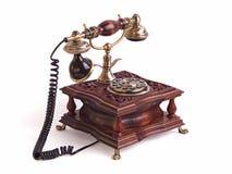 Retro telefono fisso isolato sui precedenti bianchi Fotografia Stock