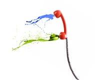 Retro telefoon en uitbarstingen van kleur. stock afbeeldingen