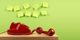 Retro Telephone. Red office telephone. Busy office concept Royalty Free Stock Photos