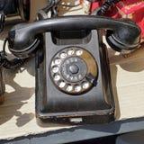 Retro telephone. Black bakelite retro telephone at flea market Royalty Free Stock Image