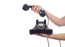 Retro Telephone Call. A woman holds a retro telephone stock photo
