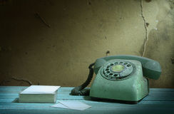 Retro telephone and card Stock Photography