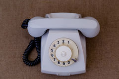 Retro Telephone. Gray on brown tablecloth Stock Images