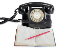 Retro telephone and notebook Royalty Free Stock Photography