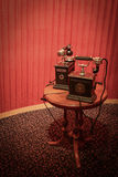 Retro telephone. Old fashioned telephone in a setting contemporary with its age stock images
