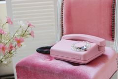 Old pink home phone. Wired vintage phone. Retro Stock Images
