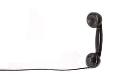 Retro telephone receiver. Isolated on white Royalty Free Stock Photo