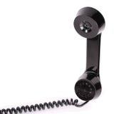 Retro telephone receiver. On white background Stock Photo