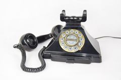 Retro Telephone, receiver picked up and laid next to the phone stock photo