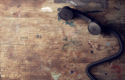 Retro telephone reciever on wooden table Royalty Free Stock Photo