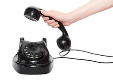 Retro telephone with woman hand Stock Photos