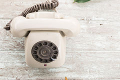 Retro telephone on wood table Royalty Free Stock Photography