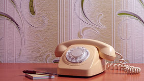 Retro telephone on wooden table in front gradient background Royalty Free Stock Image