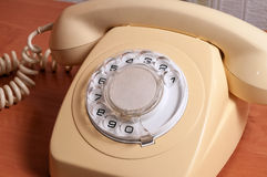 Retro telephone on wooden table in front gradient background.  Stock Image