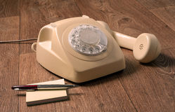 Retro telephone on wooden table in front gradient background Stock Photography
