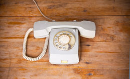 Retro telephone on wooden table Royalty Free Stock Photos