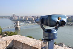 Retro telescope and blurred city of Budapest Stock Photos