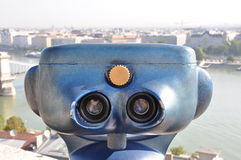 Retro telescope and blurred city of Budapest Royalty Free Stock Photo
