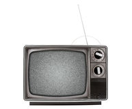 Retro Television. An old retro television with a bad signal, represented by analog snow.  Has both a UHF and VHF antenna.  TV is isolated on a white background Royalty Free Stock Photo