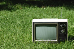 Retro Television. Retro seventies television sitting in long grass Royalty Free Stock Photography
