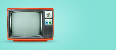 Retro television on colour background. Retro television - old vintage tv on color background. retro technology. flat lay, top view hero header. vintage color stock photo