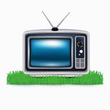 Retro television on grass isolated Royalty Free Stock Photography