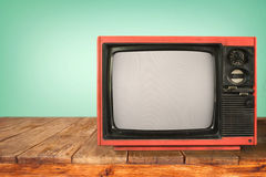 Retro television. Old TV on wood table, vintage technology Royalty Free Stock Photo