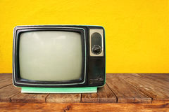 Retro television. Old TV on wood table, vintage technology Stock Images