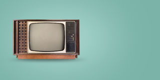 Retro television. Old vintage tv on color background. retro technology. flat lay, top view hero header. vintage color styles Royalty Free Stock Photography