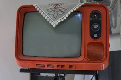 Retro television - old vintage tv on pastel color background. retro technology. Retro orange television on the wall royalty free stock photo