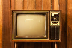 Retro television. Old vintage television and wood wall Stock Photo
