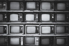 Retro television. Pattern wall of pile black and white retro television TV - vintage filter effect style Royalty Free Stock Photos