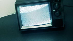 Retro Television & Static. Old generic tv with static sitting on floor against an industrial block wall. Shot on HD 1080p stock video footage
