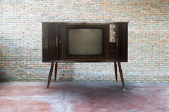 Retro television or tv. In  room Royalty Free Stock Photos