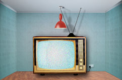 Retro television. Wide Retro television in an empty room, static station.Digital composite royalty free stock photography