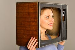 Retro television. woman with retro television set on head. retro television set in hands of girl. retro television. Concept. watch tv stock image