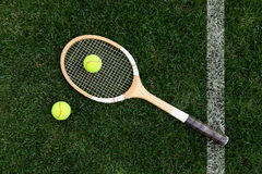 retro tennis racket on natural grass with balls Royalty Free Stock Photography