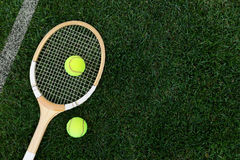 Retro tennis racket on natural grass with balls Stock Images