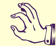 Retro tenuta d'annata della mano qualcosa fra il pollice ed il dito indice Fotografia Stock
