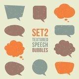 Retro textured speech bubbles set Stock Photos