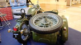 Retro three wheels military motorcyle view from the back Stock Photos