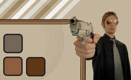 Retro Thug. Retro 70s thug gangster holds his firearm up at gunpoint with oldschool brown graphic design patterns around him making a background Royalty Free Stock Images