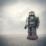 Retro tin robot toy. A  retro tin robot toy on an apocalyptic background Royalty Free Stock Photography