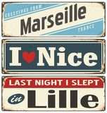 Retro tin sign collection with  French cities. Retro tin sign collection with French cities. Vintage  souvenir sign or postcard templates. Travel theme Stock Photos