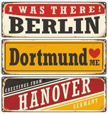 Retro tin sign collection with German cities. Vintage  souvenir sign or postcard templates Stock Images