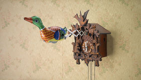 Retro tin toy duck coming out of cuckoo clock Stock Images